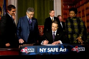 Gov. Cuomo signs the SAFE Act.