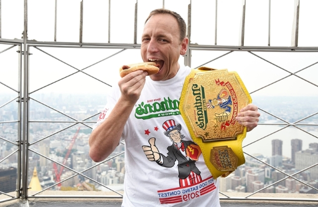 joey-chestnut-claims-12th-title-at-nathan-s-famous-hot-dog-eating-contest__657436_